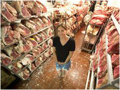 Jody Storch shows off the hundreds of short loins of USDA Prime beef aging in the meat locker.